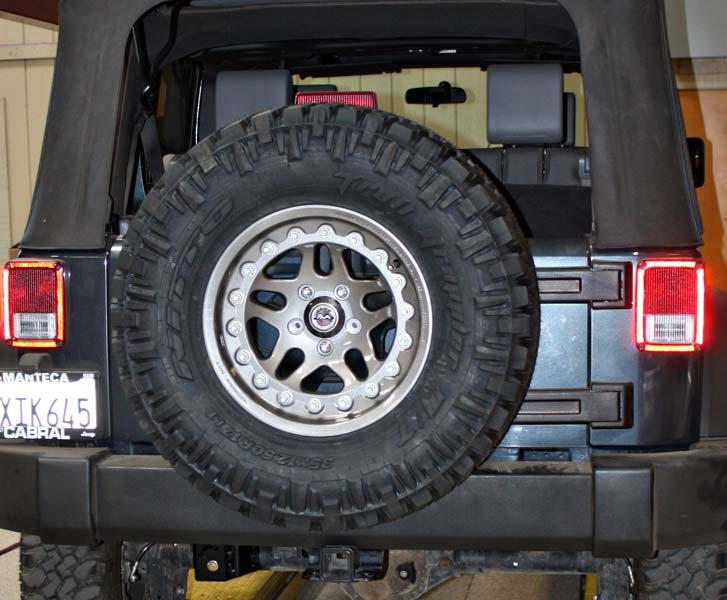Argent Hutchinson rock monster bead lock wheels with nitto tire spare installed